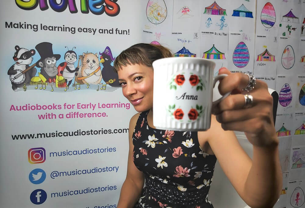 Anna Christina from Music Audio Stories on her YouTube video film set drinking tea image